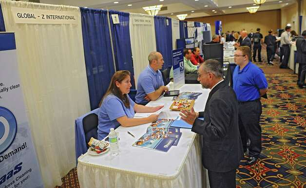 People to representatives from different companies during the third annual Tech Career Expo at the Albany Marriott on Monday, Sept. 8, 2014 in Colonie, N.Y. (Lori Van Buren / Times Union) Photo: Lori Van Buren / 00028509A
