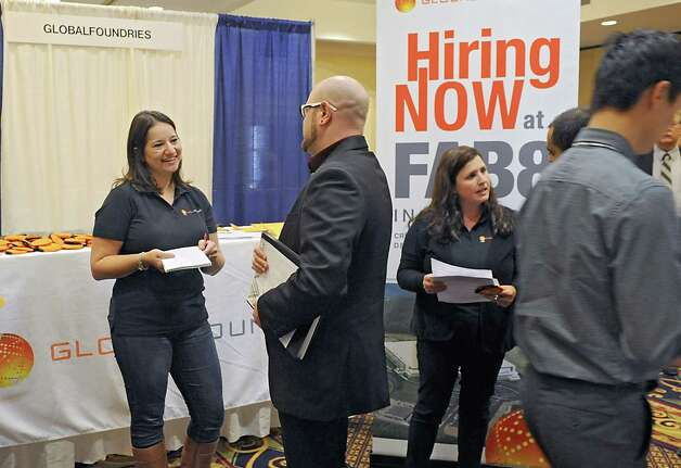 Grace Freer of GlobalFoundries, left, talks to Collin Martino of Schenectady during the third annual Tech Career Expo at the Albany Marriott on Monday, Sept. 8, 2014 in Colonie, N.Y. (Lori Van Buren / Times Union) Photo: Lori Van Buren / 00028509A