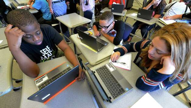 Latrell Jackson, left,  Kyle Locklear, center and Kayla Rivera, members of the inaugural class of the Troy Riverfront  P-tech program work on their projects at Troy High School.   (Skip Dickstein/Times Union) Photo: SKIP DICKSTEIN / 00028477A