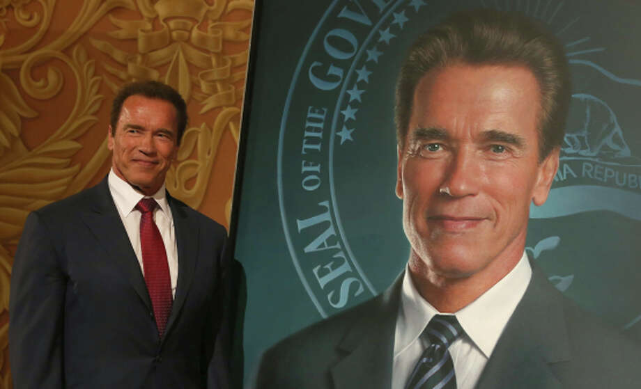 Arnold Schwarzenegger presents his gubernatorial portrait at the Capitol. Photo: Justin Sullivan, Staff / Getty Images / 2014 Getty Images