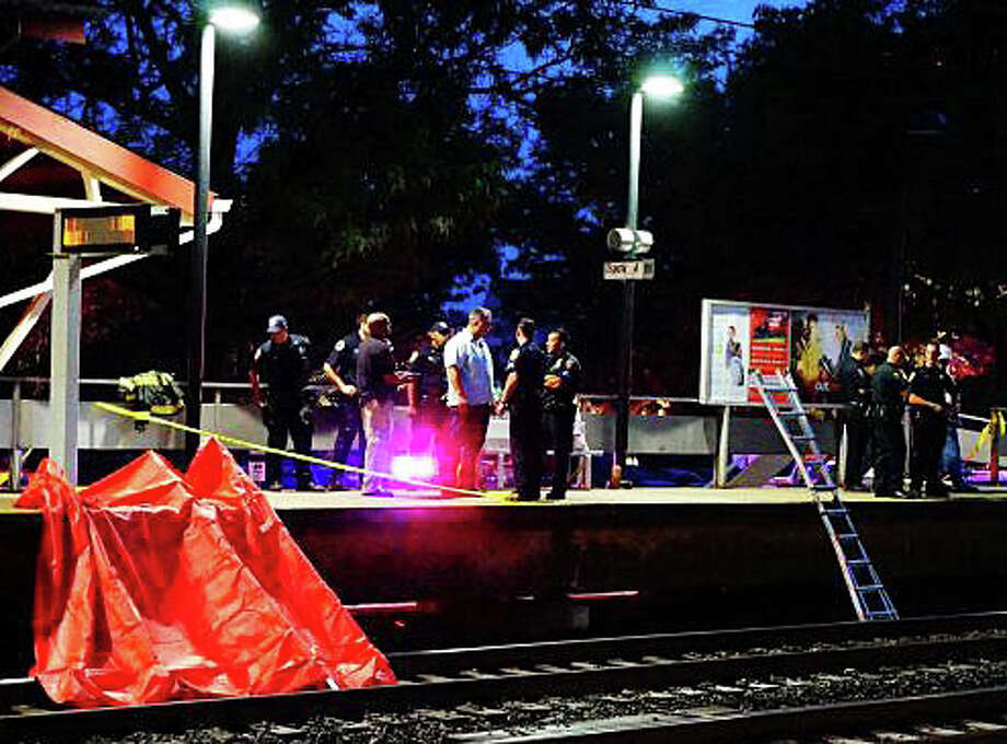 Emergency personnel at the eastbound platform of the Fairfield Railroad Station where a man on the tracks was killed Saturday evening by an Amtrak train. Photo: Genevieve Reilly / Fairfield Citizen