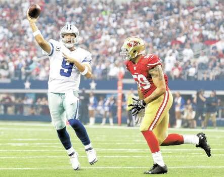 Dallas Cowboys quarterback Tony Romo (9) throws an interception to San Francisco 49ers inside linebacker Patrick Willis under pressure from linebacker Aaron Lynch (59)during the first half of an NFL football game, Sunday, Sept. 7, 2014, in Arlington, Texas. (AP Photo/LM Otero) Photo: LM Otero, Associated Press / AP