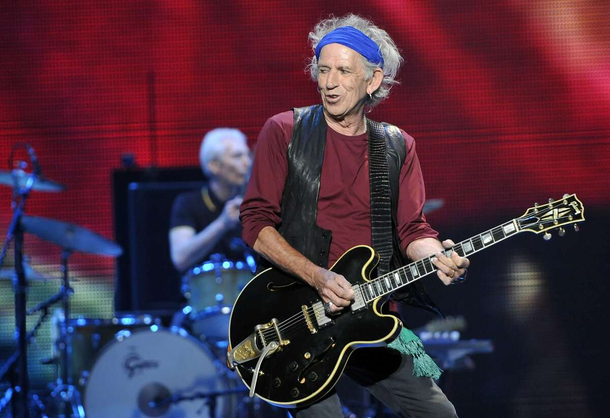 """FILE - This May 3, 2013 file photo shows Keith Richards of the Rolling Stones performing at the kick-off of the band's """"50 and Counting"""" tour in Los Angeles. Richards has a children's book """"Gus & Me: The Story of My Granddad and My First Guitar,"""" with illustrations by his daughter, Theodora, released on Sept. 9, 2014. (Photo by Chris Pizzello/Invision/AP, File)"""
