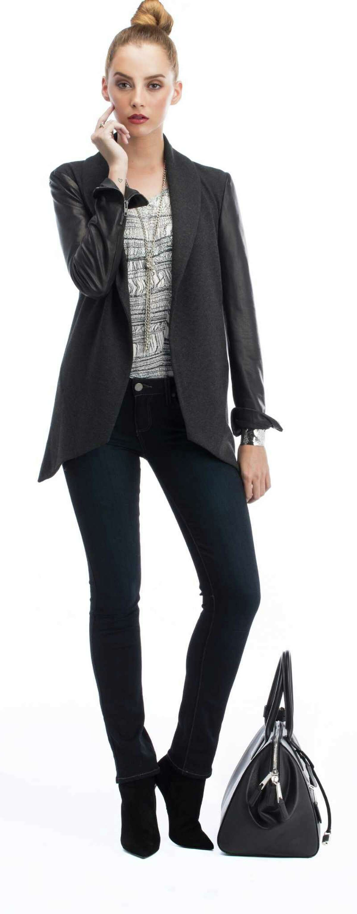 FiDi FRIDAY Go beyond the basic blazer: This marbled silk T-shirt reads like a blouse when tucked in, says Rooney. The jacket, with its charcoal knit shawl collar and leather sleeves, gives the look a slight edge. Theory Laura blazer in Dark Charcoal, $615; Saint Laurent Paris bootie, $895; Marc Jacobs medium Incognito leather satchel in black nickel, $2,300; www.nordstrom.com. Raquel Allegra Shred Print blouse, $240, Crimson Mim, 322 Main St., Los Altos, www.crimsonmim.com. Sweet & Spark vintage silver chain, $68, www.sweetandspark.com. Svelte Metals Medina cuff, $175, and Findley ring, $135, www.sveltemetals.com. Stylist: Caroline Rooney; Hair and Makeup: Erika Taniguchi / BeautybyErika.com; Model: Hanna / Scout