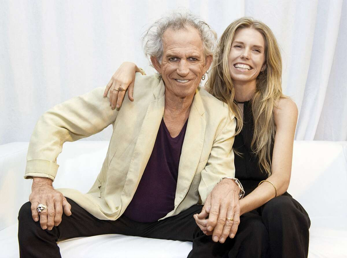"""This undated image released by Mindless Records shows Keith Richards, of The Rolling Stones, left, with his daughter Theodora Richards. """"Gus & Me: The Story of My Granddad and My First Guitar,"""" by Keith Richards and art by Theodora Richards. The book will be released on Sept. 9, 2014. (AP Photo/Mindless Records, Brian Rasic)"""
