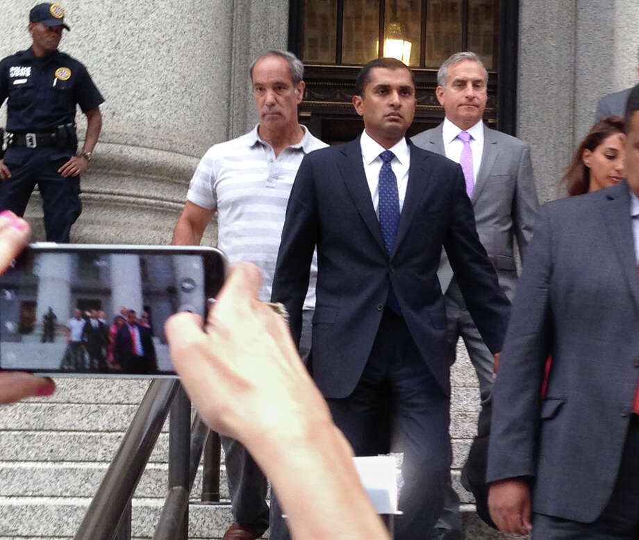 Mathew Martoma, center, leaves court Monday after being sentenced to nine years in an inside trading case. He had worked for SAC Capital Advisors. Photo: Larry Neumeister, STF / AP