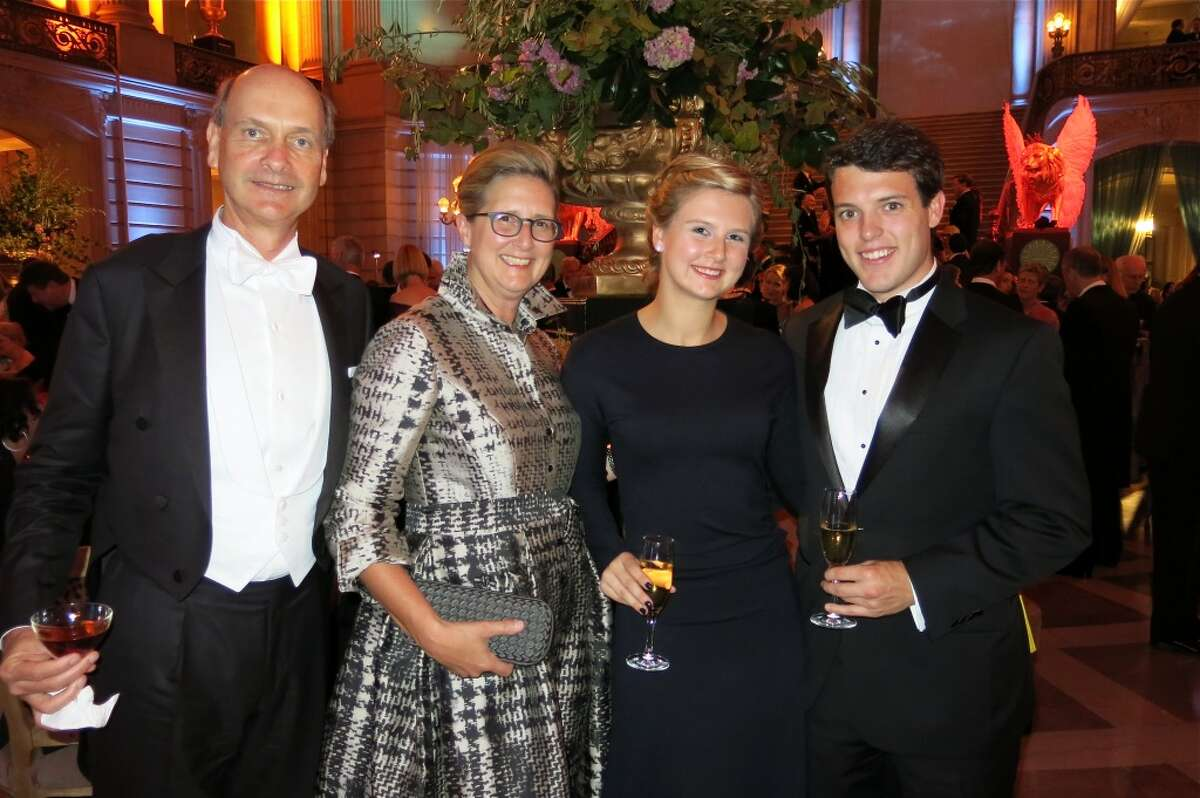 Keith Geeslin (at left) with his wife, Prisca Geeslin (in Carolina Herrera), their daughter Catherine and pal, John Oberbeck.