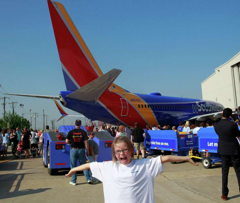 Indigo Pyles, 10, strikes a pose during an event Monday in Dallas unveiling a new color scheme for Southwest Airlines jets. The airline has a major presence at Houston's Hobby Airport. Photo: David Woo / The Dallas Morning News