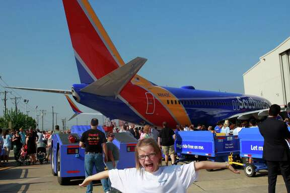 Indigo Pyles, 10, strikes a pose during an event Monday in Dallas unveiling a new color scheme for Southwest Airlines jets. The airline has a major presence at Houston's Hobby Airport.