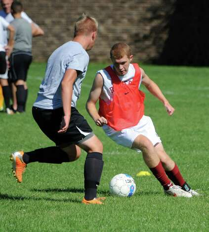 One of Colonie's team captains Sheamus Kavanaugh, right, dribbles the ball during soccer practice on Monday, Sept. 8, 2014 in Colonie, N.Y. (Lori Van Buren / Times Union) Photo: Lori Van Buren / 00028508A