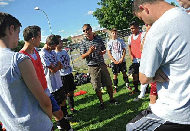 Colonie boy's soccer coach Mike Trimarchi talks to his team during soccer practice on Monday, Sept. 8, 2014 in Colonie, N.Y. (Lori Van Buren / Times Union) Photo: Lori Van Buren / 00028508A