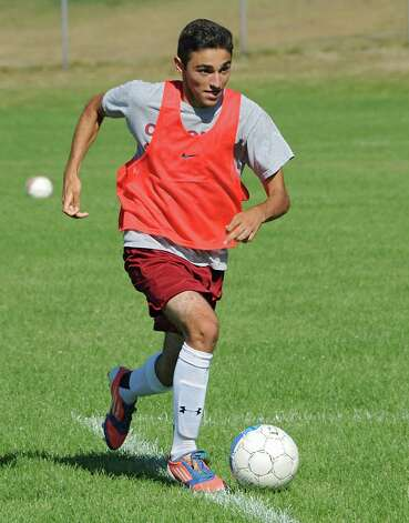 One of Colonie's team captains Matteo Curto dribbles the ball during soccer practice on Monday, Sept. 8, 2014 in Colonie, N.Y. (Lori Van Buren / Times Union) Photo: Lori Van Buren / 00028508A