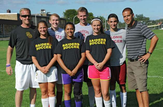 From left to right, Colonie girl's coach Nick Southworth, Sarah DiBernardo, Sheamus Kavanaugh, Alexis Eddy, Matt Walsh, Kaleigh Fowler, Matteo Curto and boy's coach Mike Trimarchi on Monday, Sept. 8, 2014 in Colonie, N.Y. The teams will be playing a doubleheader fundraiser for a former player with cancer. (Lori Van Buren / Times Union) Photo: Lori Van Buren / 00028508A