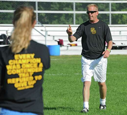 Colonie girl's soccer coach Nick Southworth talks to his team during soccer practice on Monday, Sept. 8, 2014 in Colonie, N.Y. (Lori Van Buren / Times Union) Photo: Lori Van Buren / 00028508A