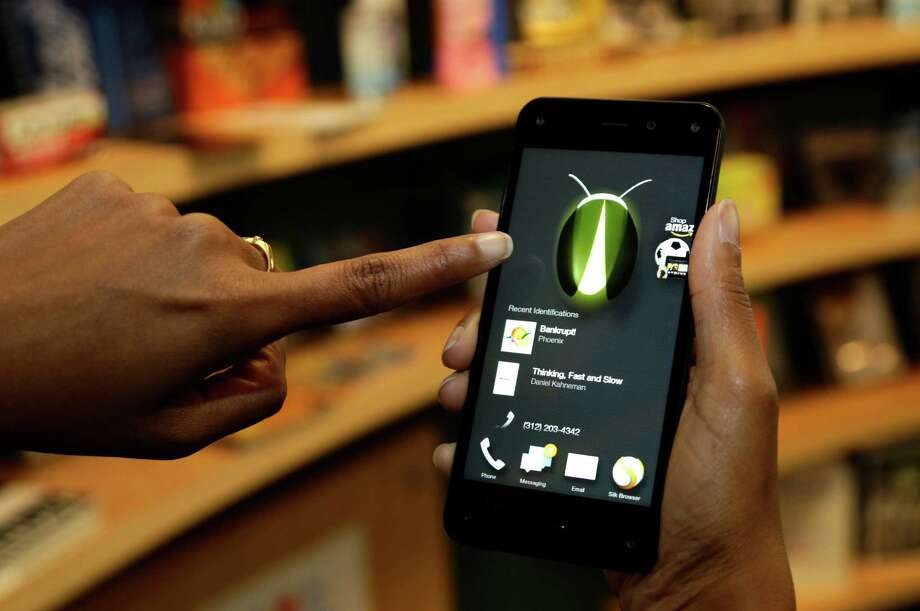 The new Amazon Fire smartphone hasn't been a hot seller.  Photo: Ted S. Warren, STF / AP