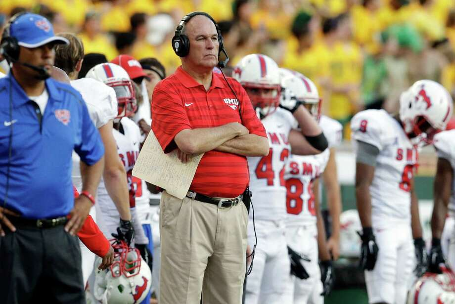 FILE - In an Aug. 31, 2014, file photo SMU head coach June Jones watches from the sidelines during the first half of an NCAA college football game against Baylor in Waco, Texas.  Jones resigned as SMU's coach Monday, Sept. 8, 2014,  after the Mustangs scored only one touchdown in losing their first games this season.   (AP Photo/LM Otero) Photo: LM Otero, STF / AP