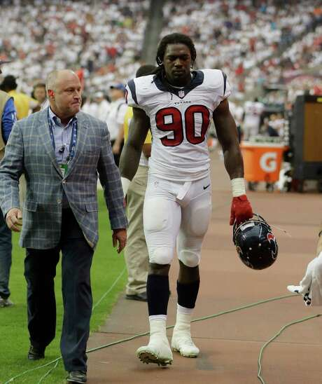 Houston Texans' Jadeveon Clowney (90) leaves with a knee injury during the second quarter of an NFL football game against the Washington Redskins, Sunday, Sept. 7, 2014, in Houston. (AP Photo/Patric Schneider) Photo: Patric Schneider, FRE / FR170473 AP