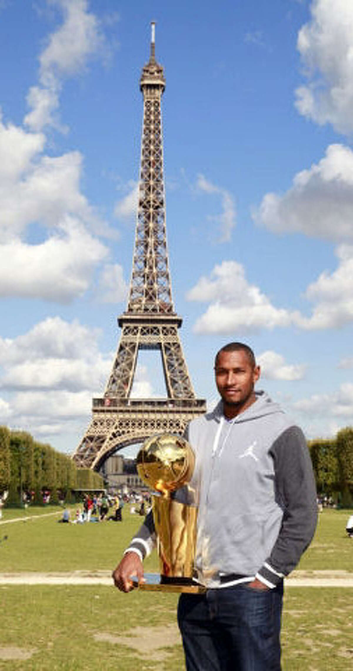 Spurs forward Boris Diaw took the Larry O'Brien Trophy to the Eiffel Tower in Paris