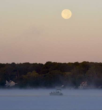 The harvest moon hangs above Saratoga Lake on Tuesday, Sept. 9, 2014. (Skip Dickstein / Times Union)