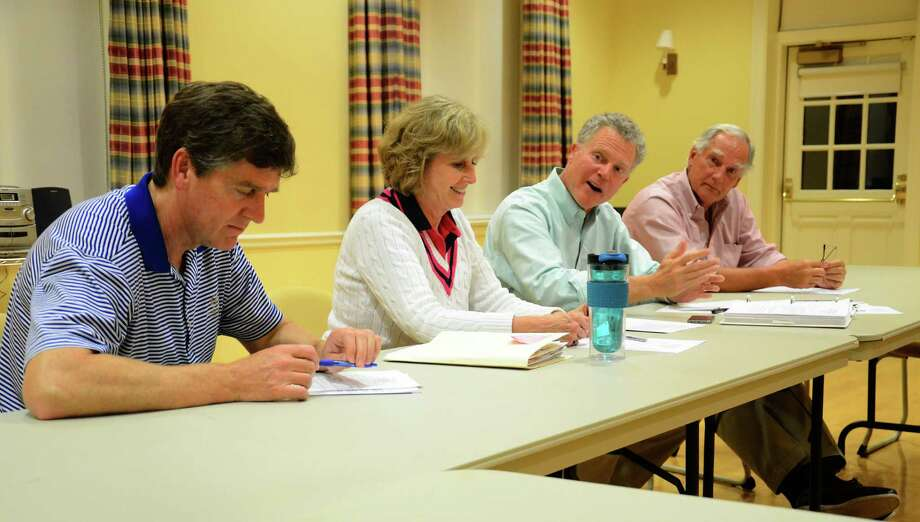 """Parking Commission members Patrick Swearingen, left, Pamela Crum, Keith Richey and Peter Ogilvie discuss a """"once-per-day"""" proposal for on-street parking on Elm and Main streets in New Canaan, Conn., during a meeting at Lapham Community Center Thursday, Sept. 4, 2014. Photo: Nelson Oliveira / New Canaan News"""
