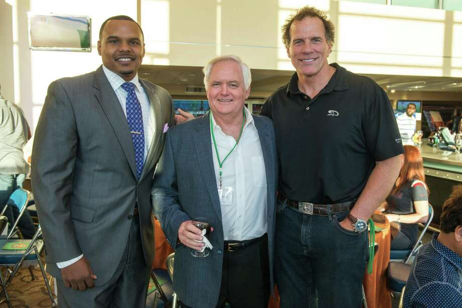 Chester Pitts, from left, Wade Phillips and Ray Childress at NRG Stadium for the 2nd annual Fantasy Football Draft Night benefiting the Boys & Girls Harbor Photo: Michelle Watson, Photographer / Owner / © 2014 Michelle Watson. All rights reserved.