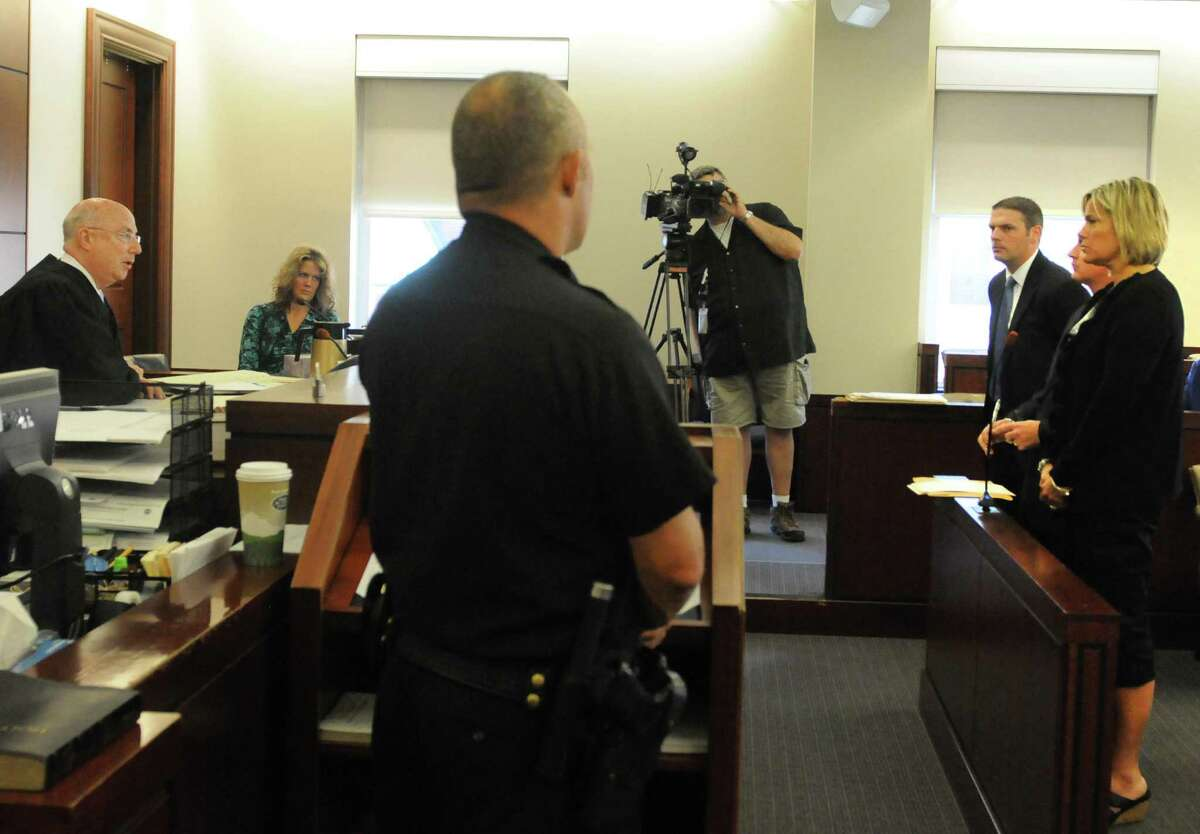 Farnsworth Middle School math teacher Brenda McClaine, right, appears before Albany County Judge Stephen Herrick, left, to answer grand larceny charges for allegedly stealing $100,000 over the course of one year from the Guilderland Teachers Association Tuesday morning, Sept. 9, 2014, at Albany County Court in Albany, N.Y. (Michael P. Farrell/Times Union)