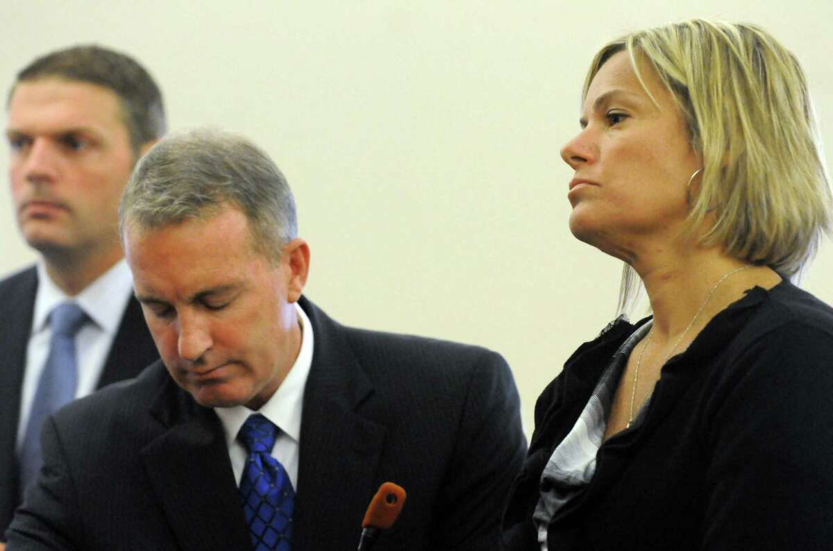 Farnsworth Middle School math teacher Brenda McClaine, right, appears before Albany County Judge Stephen Herrick to answer grand larceny charges for allegedly stealing $100,000 over the course of one year from the Guilderland Teachers Association Tuesday morning, Sept. 9, 2014, at Albany County Court in Albany, N.Y. (Michael P. Farrell/Times Union)
