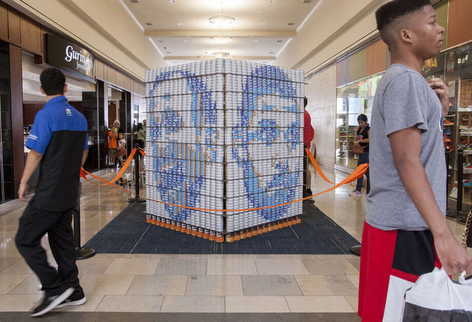 "Built with cans of tuna, ""Canpions"" pays homage to Spurs superstars Tim Duncan, Tony Parker and Manu Ginobili. Photo: Photos By Julysa Sosa / For The Express-News / Julysa Sosa For the San Antonio Express-News"