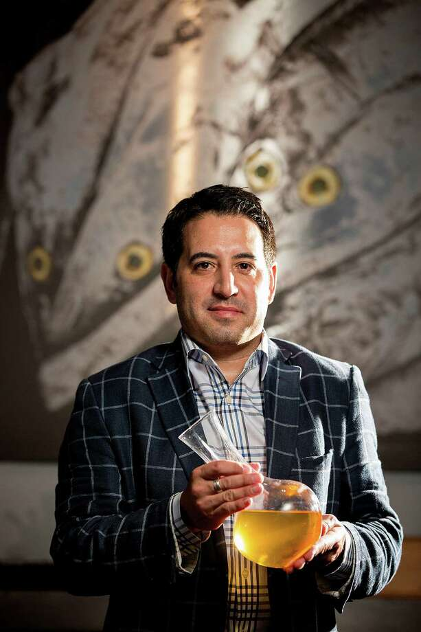 Rob Ortiz, manager and sommelier at Holley's Seafood, suggests  Kalin Cellars' 1995 Chardonnay Cuvée LV. Photo: Johnny Hanson, Staff / © 2014  Houston Chronicle