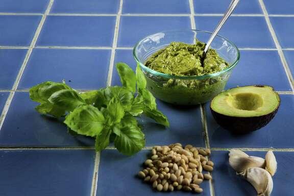 Make avocado pesto with avocado, basil, pine nuts, garlic and olive oil.