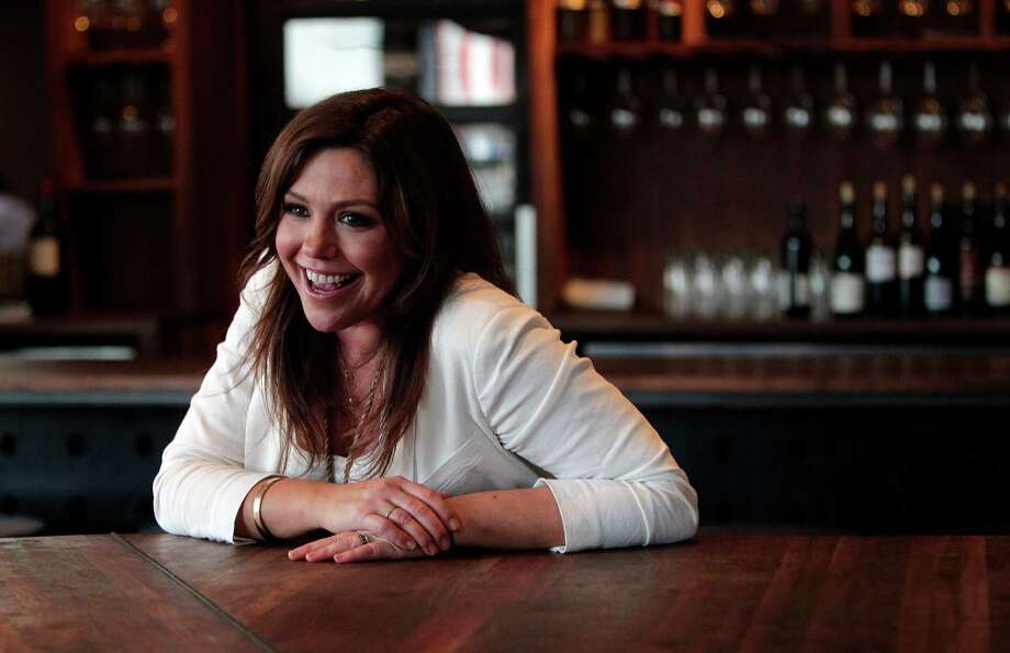 Rachael Ray, talk-show host, author and food personality, participates in an interview at Underbelly, where she also enjoyed a quick lunch after taping promotional spots for her show. Photo: Mayra Beltran, Staff / © 2014 Houston Chronicle