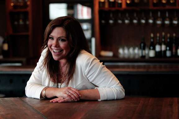 Rachael Ray, talk-show host, author and food personality, participates in an interview at Underbelly, where she also enjoyed a quick lunch after taping promotional spots for her show.