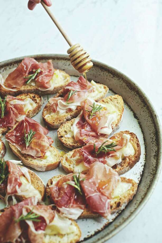 Prosciutto and Piave Crostini with Acacia Honey is among the recipes featured in the cookbook. Photo: Central Market / Central Market