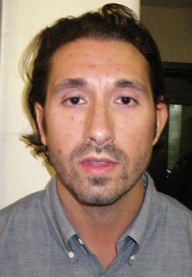 David Lafrance, 33 of Stamford faces several charges after police said he tried to illegally obtain a drug prescription at a Westport pharmacy using false information. Photo: Westport Police Department / Westport News