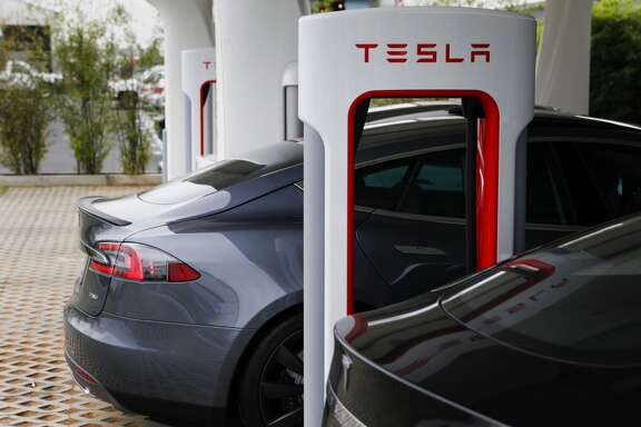 A Tesla Motors Inc. Model S Roadster vehicle is charged at company's design studio in Hawthorne, California.