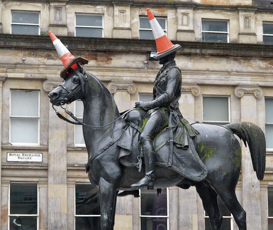 The statue of the Duke of Wellington in Glasgow, Scotland, is rarely seen without a traffic cone on its head. It started as a joke by students decades ago but is now an almost permanent symbol of local humor. Photo: Stewart Cunningham, HOEP / Stewart Cunningham