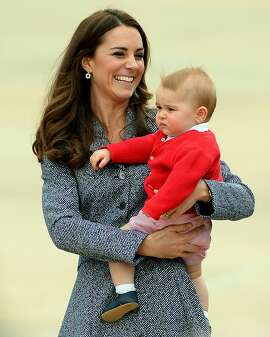 """(FILES) A file picture taken on April 25, 2014, shows Britain's Catherine, Duchess of Cambridge, with her son Prince George at the Defence Establishment Fairbairn in Canberra, Australia. Prince William and his wife Kate are """"very pleased"""" to announce that they are expecting their second child, Kensington Palace said on Monday September 8, 2014.  AFP PHOTO / SAEED KHAN/FILESSAEED KHAN/AFP/Getty Images"""
