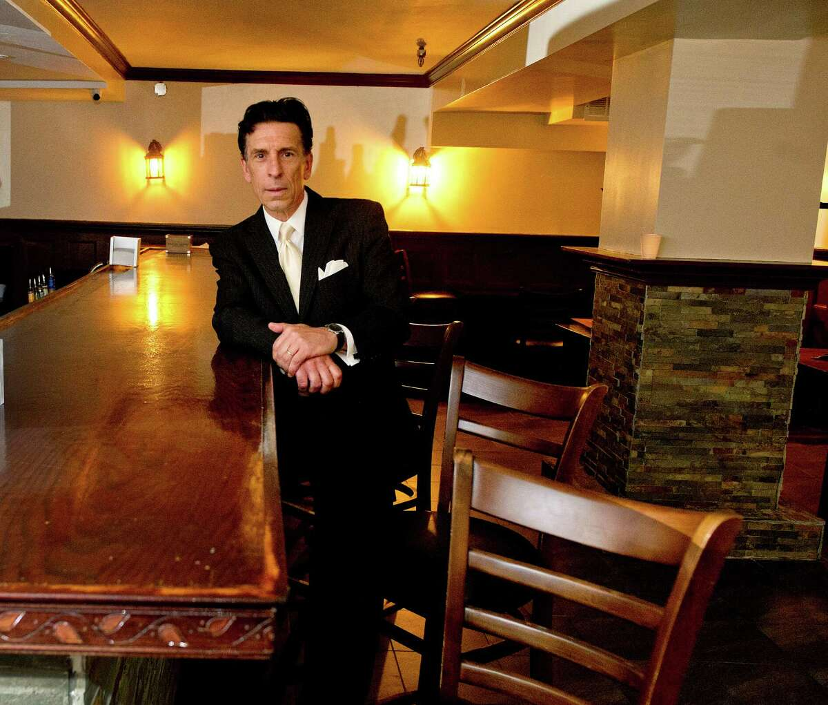Steve Matsis, Senior Managing Director for Pyramid Restaurant Group, poses for a photo at Salsa Lounge and Restaurant, the business for sale at 84 West Park Place in Stamford, Conn., on Tuesday, September 9, 2014.