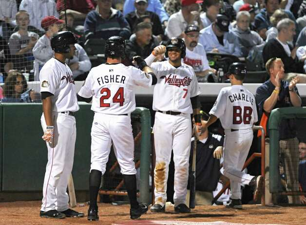 Tri-City ValleyCats' Derek Fisher, #24, gets fist bumps for stealing home from third after a wild pitch during game 2 of the New York-Penn League championship series against State College Spikes at Joe Bruno Stadium on Monday, Sept. 8, 2014 in Troy, N.Y. (Lori Van Buren / Times Union) Photo: Lori Van Buren / 00028500A