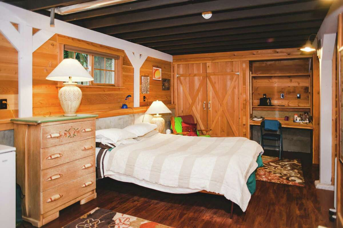 This wood-paneled Madrona basement room gives a cabin-like feel.