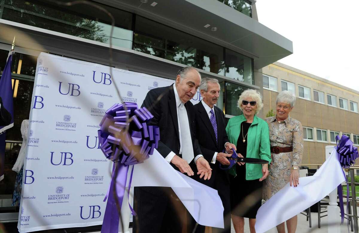 Trustee Frank Zullo, Ernest and Joan Trefz and Lt. Gov. Nancy Wyman cut the ribbon at the opening of the University of Bridgeport Ernest C. Trefz School of Business Tuesday, Sept. 9, 2014, in Bridgeport, Conn.