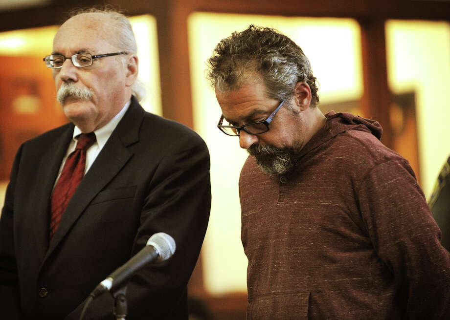 Standing with his lawyer Dennis McDonough, left, Thomas Fischer is arraigned on charges of Violation of a Protective Order at Superior Court in Bridgeport, Conn. on Tuesday, September 9, 2014. The warrant was obtained based on information obtained during the investigation of the untimely death of Jennifer Sredzinski, 41, of Monroe. Photo: Brian A. Pounds / Connecticut Post