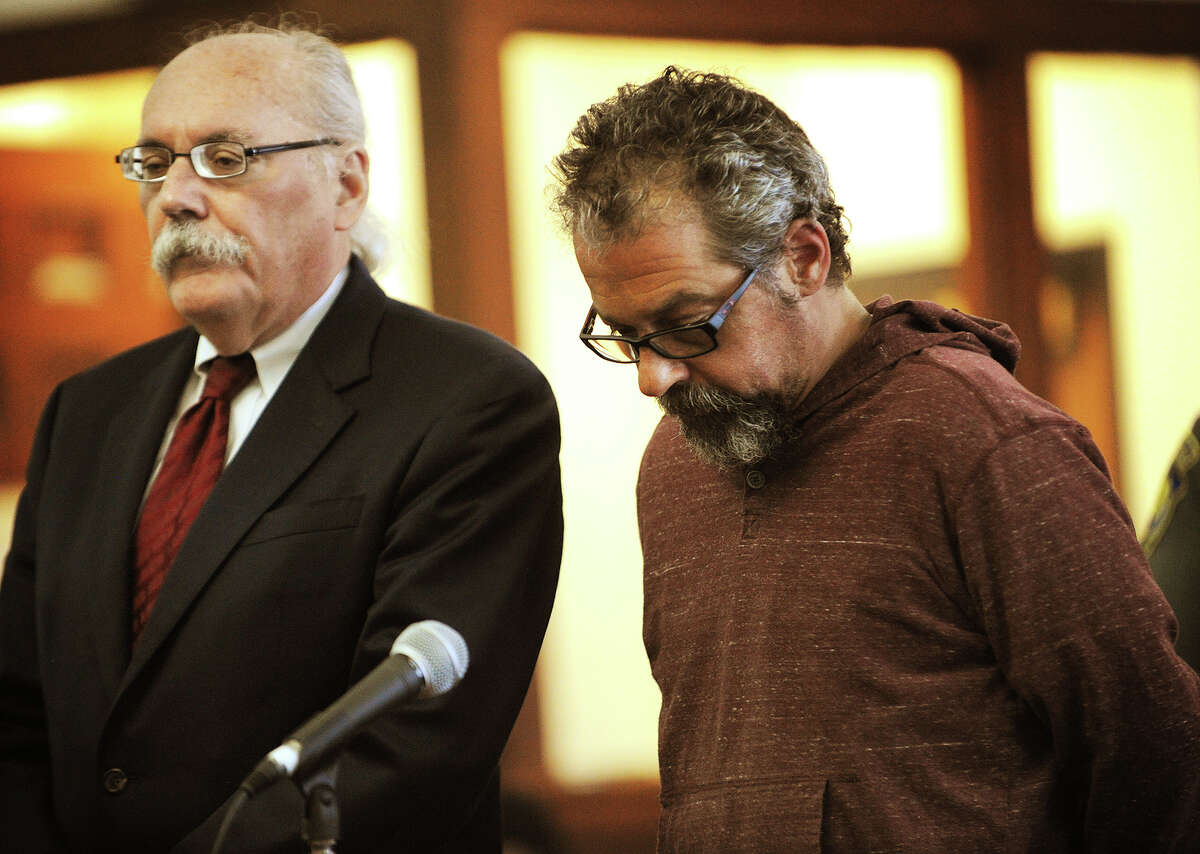 Standing with his lawyer Dennis McDonough, left, Thomas Fischer is arraigned on charges of Violation of a Protective Order at Superior Court in Bridgeport, Conn. on Tuesday, September 9, 2014. The warrant was obtained based on information obtained during the investigation of the untimely death of Jennifer Sredzinski, 41, of Monroe.