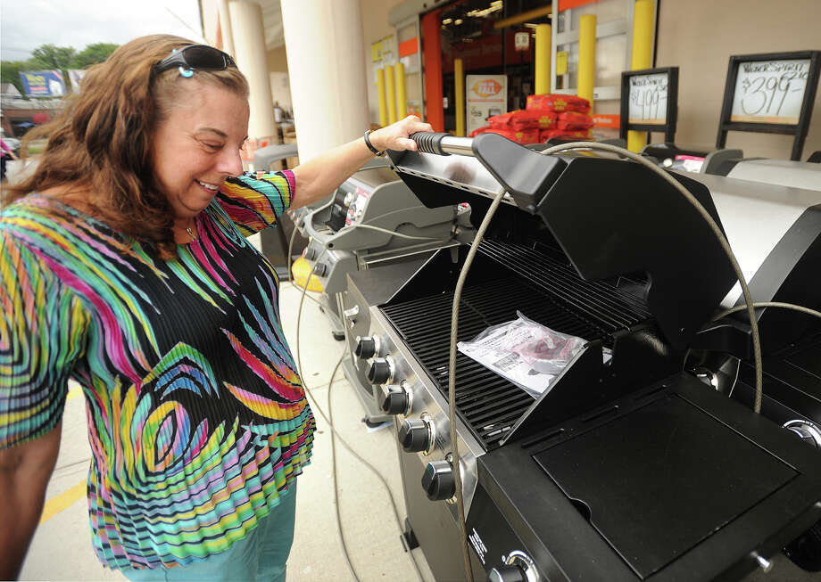 Gayle Mahalik, of Fairfield, shops for a new gas grill at the Home Depot store on King's Highway in Fairfield , Conn. on Tuesday, September 9, 2014. Mihalik said the company's announced credit card security breach won't stop her from shopping at the stores, or from using her credit card. Photo: Brian A. Pounds / Connecticut Post