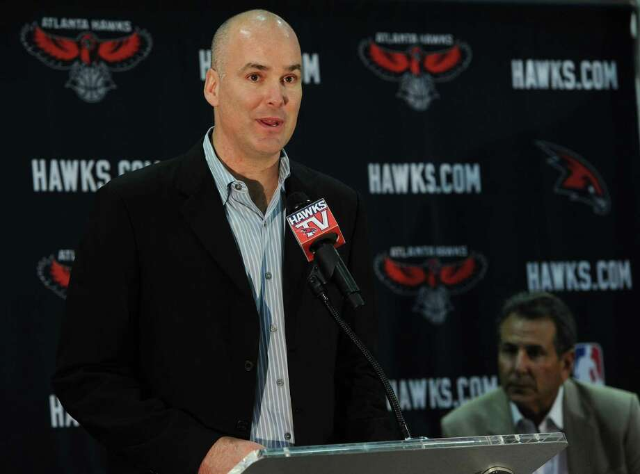 """2368 x 1756~~$~~FILE - In this June 25, 2012, file photo, Atlanta Hawks president of operations and general manager Danny Ferry speaks during a news conference in Atlanta, as team co-owner Bruce Levenson, right, looks on. Ferry has been disciplined by CEO Steve Koonin for making racially charged comments about Luol Deng when the team pursued the free agent this year. Ferry apologized Tuesday, Sept. 9, 2014,  for """"repeating comments that were gathered from numerous sources"""" about Deng. Photo: Johnny Crawford, AP / Atlanta Journal-Constitution"""