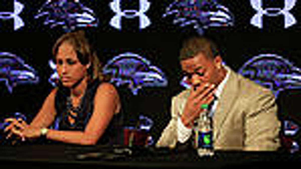 Running back Ray Rice of the Baltimore Ravens pauses while addressing a news conference with his wife Janay at the Ravens training center on May 23, 2014 in Owings Mills, Maryland. Rice spoke publicly for the first time since facing felony assault charges stemming from a February incident involving Janay at an Atlantic City casino.