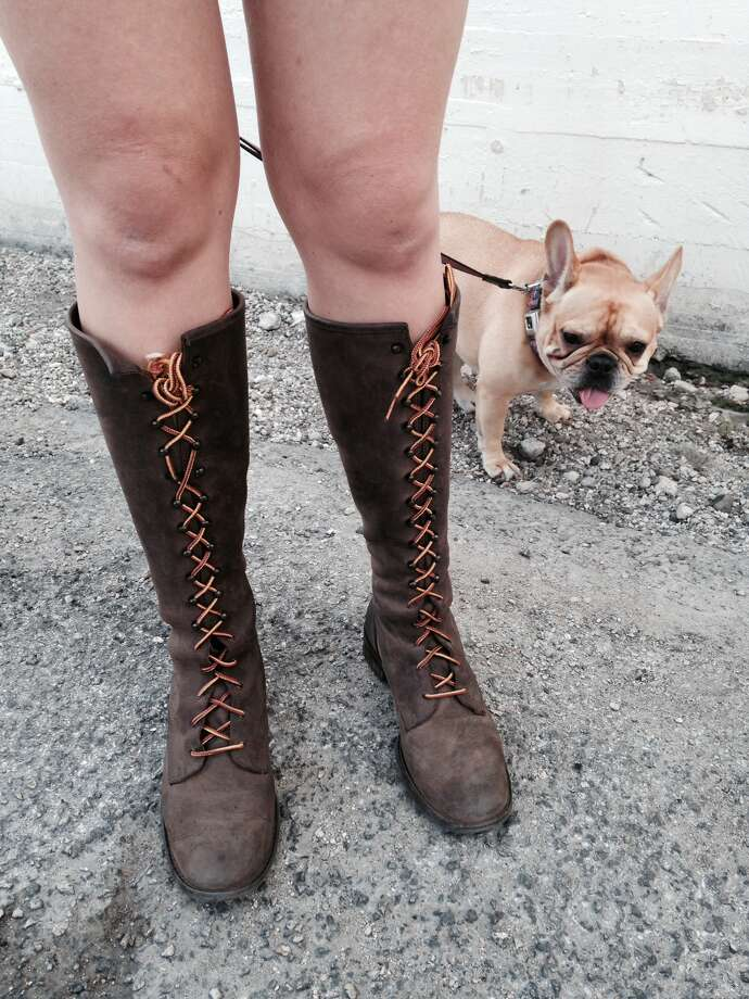 Ashley McBride's tough lace-up leather Michael Kors boots gets their approval from Lola the French bulldog. Photo: Photo By Michael Quintanilla / San Antonio Express-News