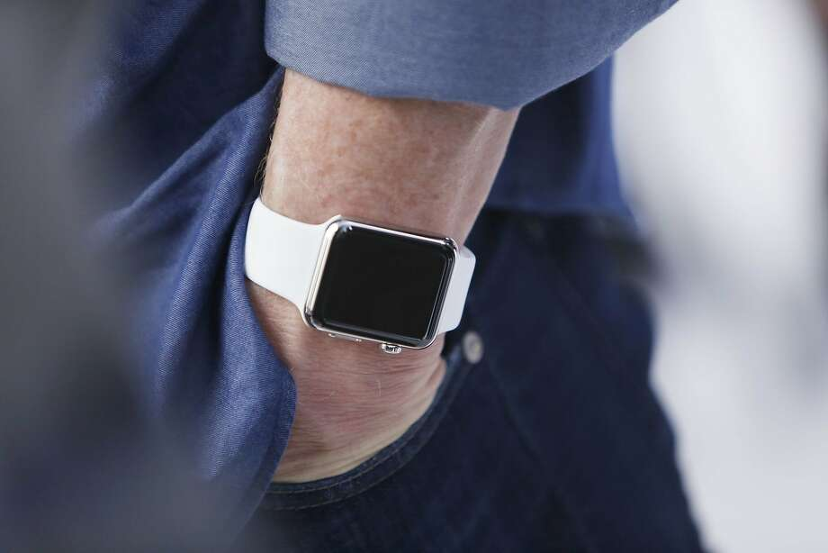 Tim Cook, Apple CEO, wears an Apple Watch on his wrist after the Apple announcement at  the Flint Center for the Performing Arts on Tuesday, September 9,  2014 in Cupertino, Calif. Photo: Lea Suzuki, The Chronicle