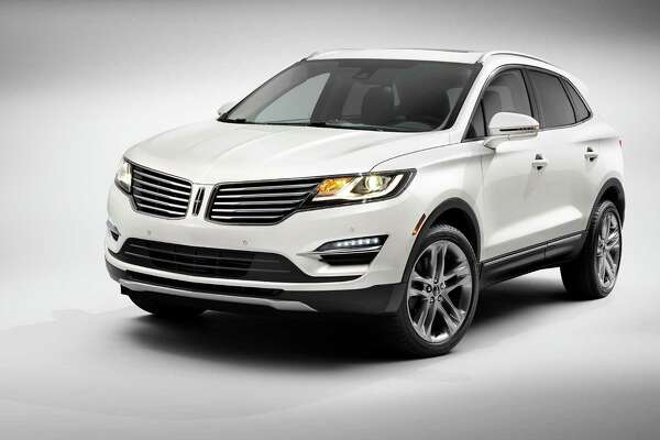 FILE - This product image provided by the Ford Motor Company shows the all-new 2015 Lincoln MKC small premium utility vehicle. It has an athletic exterior, with Lincoln's signature split-wing grille and wraparound tail lights, and some Lincoln firsts, including a system that detects when the driver is nearing the door and illuminates the ground near it.