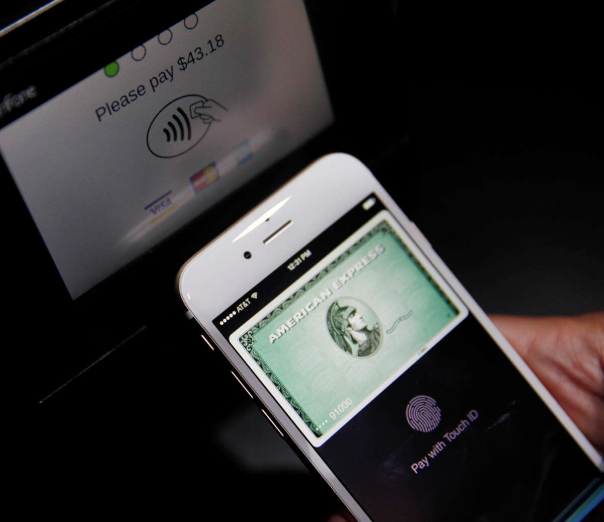 Apple Pay is demonstrated after the system was introduced in September.